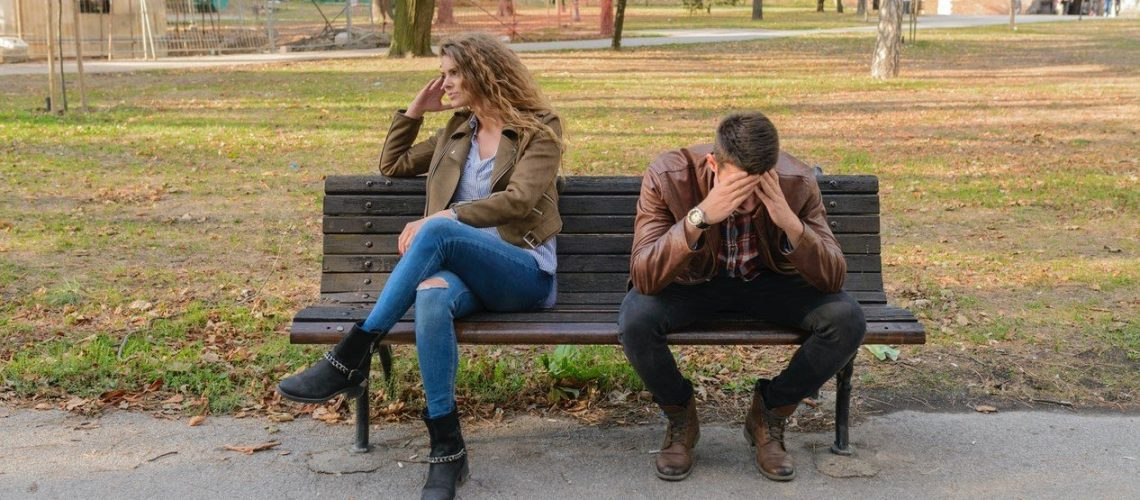 man woman park bench separated upset (2)